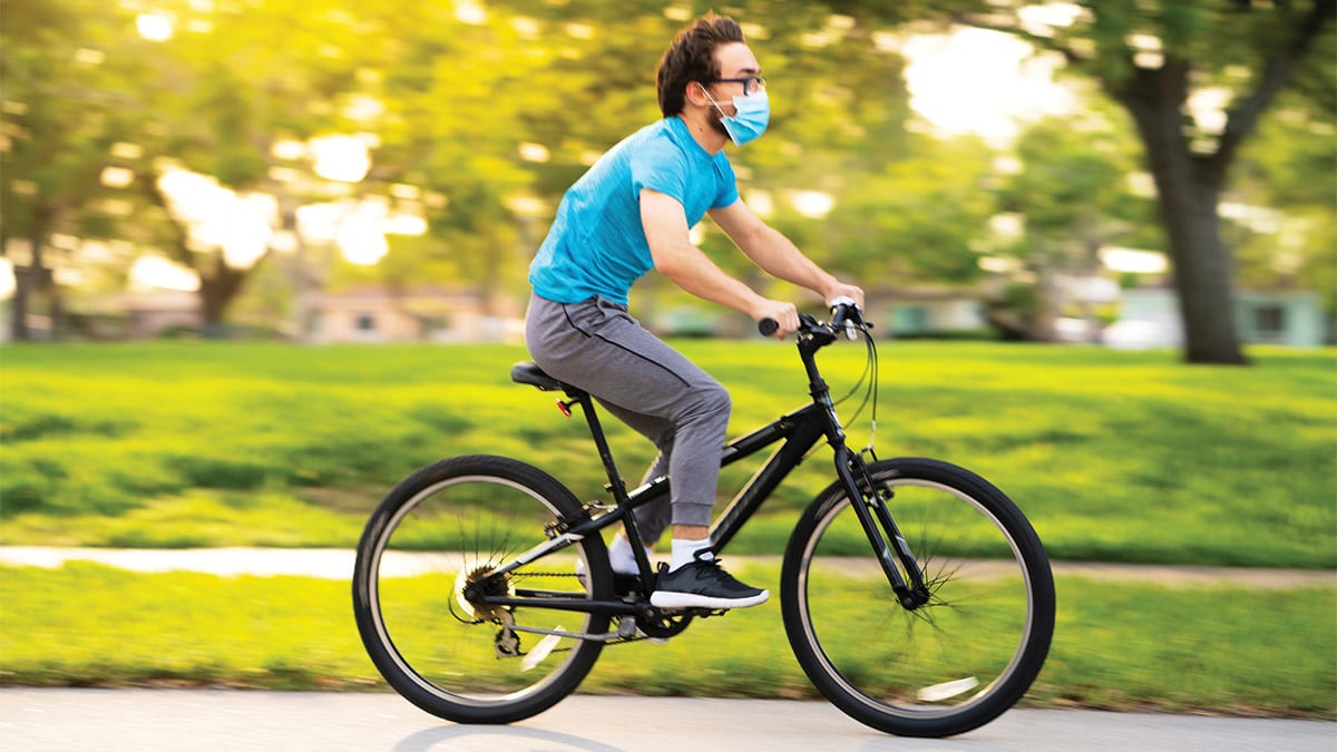 Guy riding bike with mask on